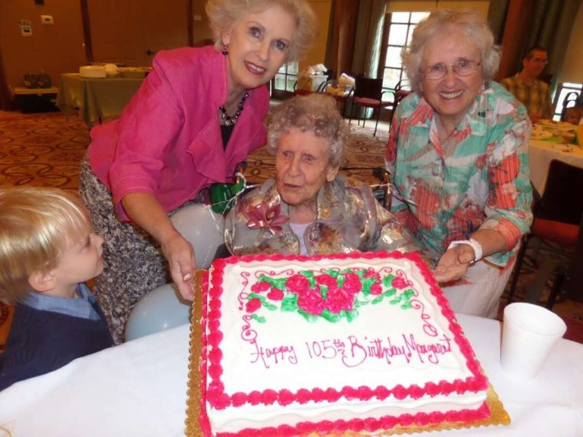 Margaret Ryan celebrates her 105th birthday with her daughters Pat Williams (left) and Dr. Charlton Ryan on May 17 at The Village at Gleannloch Farms.