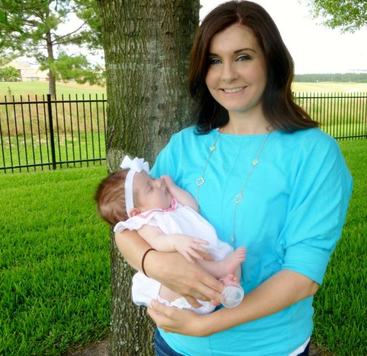 Natalie Gaudlin holds her baby, Emerson, at her home in Cypress.