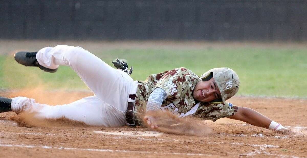 Kempner's Nick Anderson slides into home against Austin during their May 1 district game at Kempner High School in Sugar Land. The Cougars swept Brazoswood to open the Region III-6A playoffs. To view or purchase this photo and others like it, go to HCNPics.com.