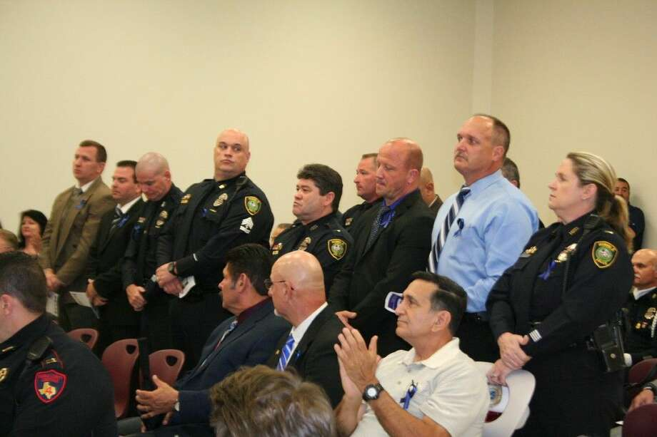 Humble Police Department peace officers stand to be recognized at the first North Houston Police Memorial Day ceremony May 11, 2015.