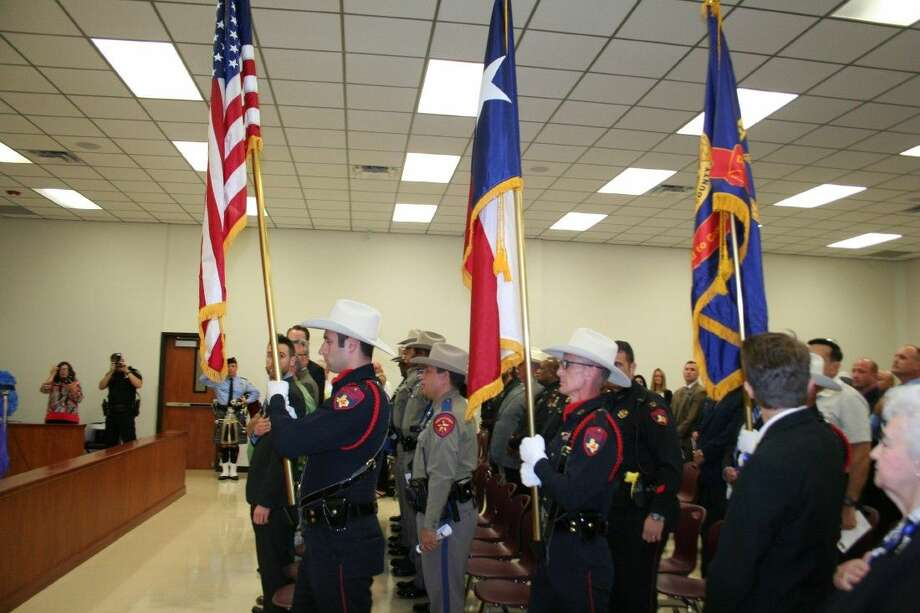 Members of the Harris County Precinct 4 Constable's Honor Guard post the colors at the first North Houston Police Memorial Day ceremony May 11, 2015.