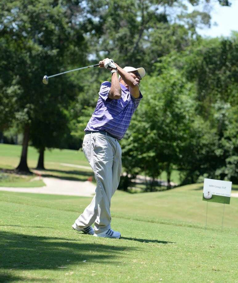 CFISD Board member Dr. John Ogletree Jr. tees off at the 26th Annual B.F. Adam Golf Classic at Blackhorse Golf Club in May 2014. The 27th annual tournament is set for May 14, 2015.