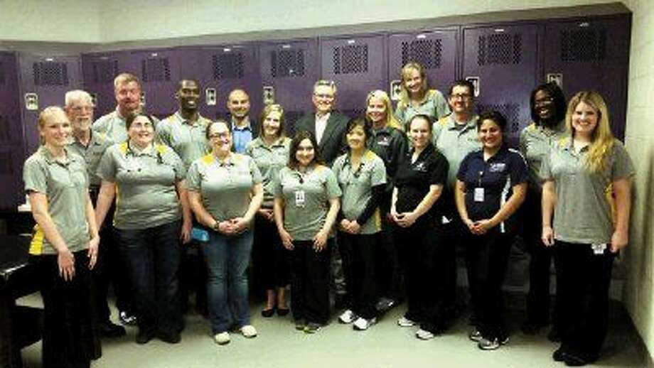 Humble City Council Member Norman Funderburk (center, back row) and Memorial Hermann Northeast Hospital senior vice president and CEO Heath Rushing (center-left, back row) joined the athletic physicals team at Memorial Hermann Northeast Hospital in the Humble High School Wildcats locker rooms. The team performed physicals on 607 middle and high school student-athletes and EKG technicians administered 122 EKGs to incoming ninth-graders.
