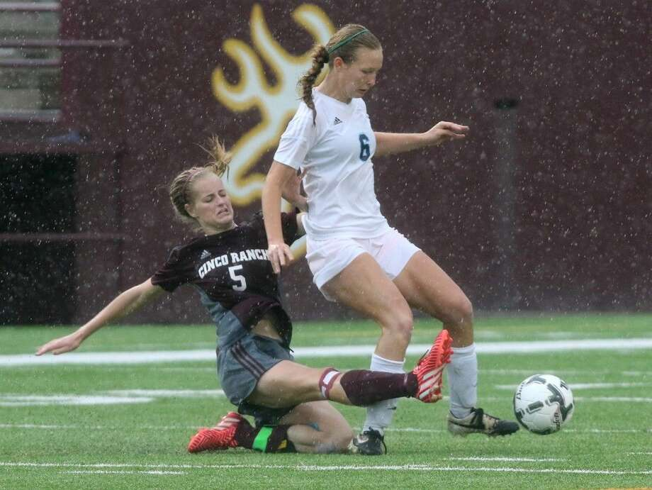 Cinco Ranch's Taryn Siegele and Clements' Allison Bellman go after a ball during the Region III-6A semifinals April 10 at Abshier Stadium in Deer Park. Bellman was voted District 23-6A Defensive MVP. To view or purchase this photo and others like it, go to HCNPics.com. Photo: Alan Warren