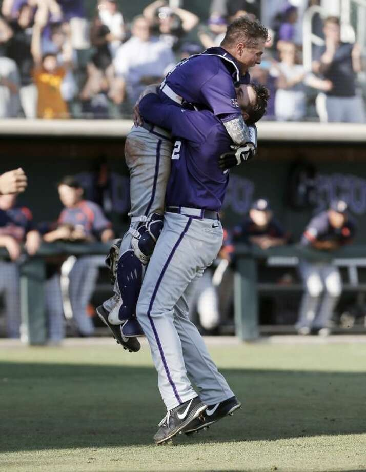 TCU catcher Kyle Bacak and relief pitcher Riley Ferrell celebrate the final out in their 6-5 win against Pepperdine in an NCAA super regional game on Monday in Fort Worth.