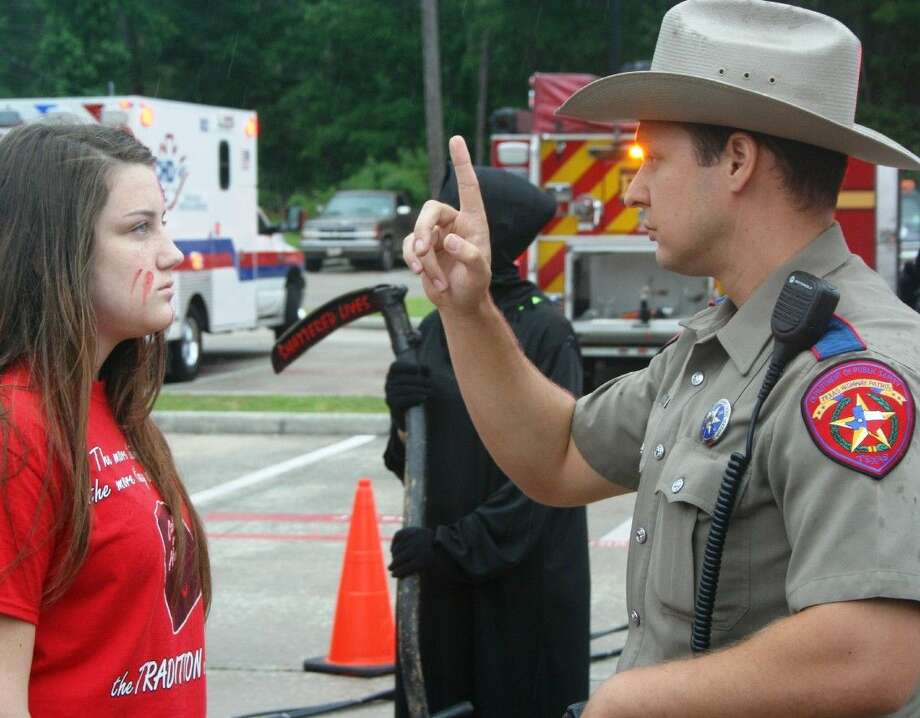 DPS Trooper Christopher Lucchesi administers a sobriety test during the Shattered Lives event at Splendora High School on Monday, May 11. Photo: Stephanie Buckner