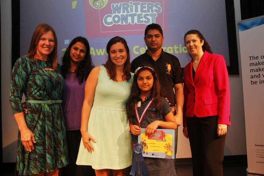 "Alvina Singh, a first grader at Askew Elementary, won first place in the 2015 Houston Public Media PBS Writers Contest for her story ""Brave."" Alvina posed with her teacher, family, children's author Chris Candor and Capella Tucker, content director of Houston Public Media, at an awards ceremony. (L to R) Chris Candor, mother Mona Lisa Samal, teacher Catherine Perez, Alvina, father Bismitp Singh, and Capella Tucker."