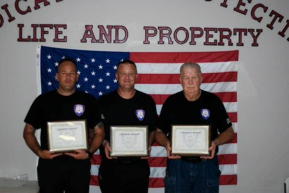 Chris Reel, Steven Grimm, and H. D. Jackson pose here with their Life Saver awards. / Houston Community Newspapers, 2014