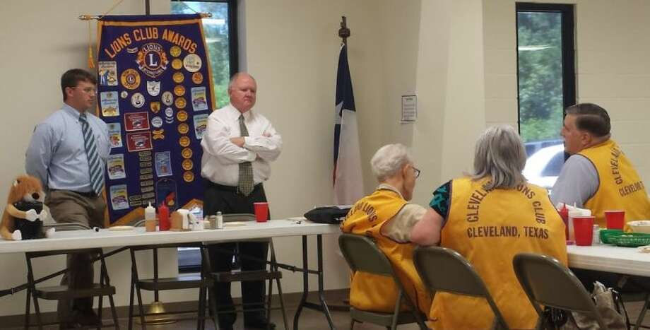 Cleveland Lions Club member Mike Penry asks First Assistant DA Steve Taylor a question following his speech regarding the death penalty at the June 10 meeting of the Cleveland Lions Club. Liberty County DA Logan Pickett was also on hand to introduce Taylor. Photo: STEPHANIE BUCKNER