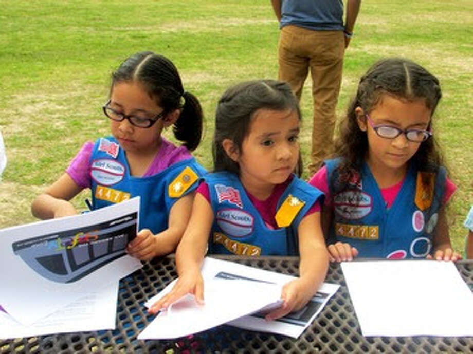 Northside-area Girl Scouts from Troop #24472 celebrate completion of the Think Rail safety patch program for light rail.