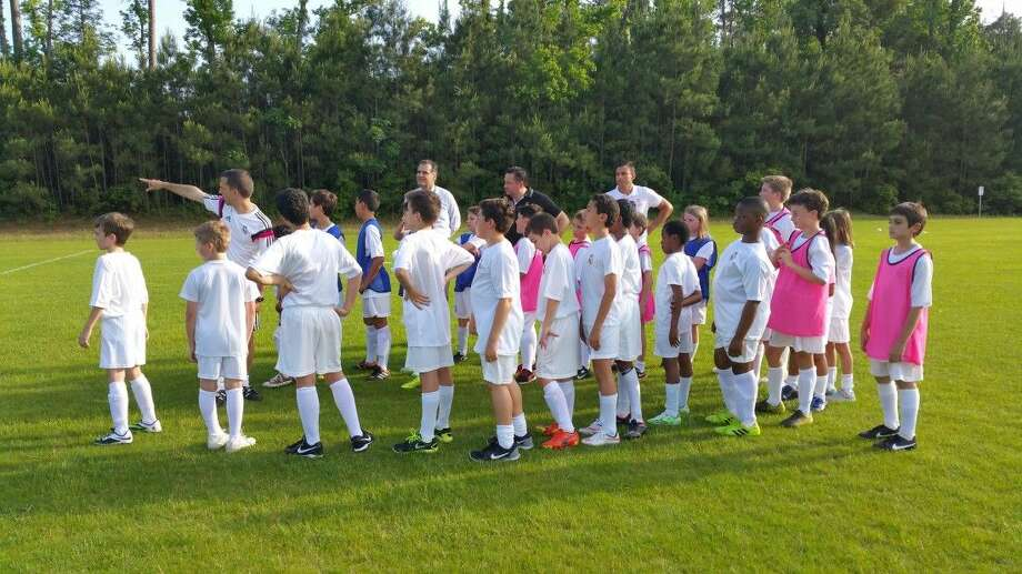 Soccer players in the Real Madrid Campus Experience learn at The Woodland Preparatory Academy in late April. More than 60 students learned about other cultures and how to enhance their soccer skills.