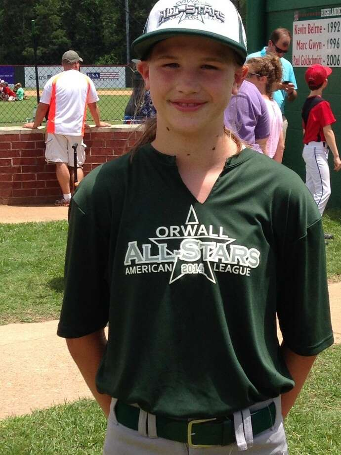 Bailey E. Brassard of The Woodlands poses during an ORWALL (Oak Ridge Woodlands Area Little League) game. Brassard will represent The Woodlands at the first national girls baseball tournament later this month.