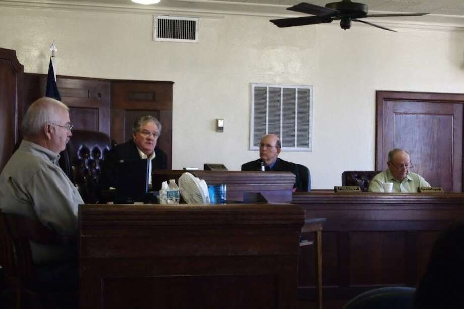 With the election behind them, judge and commissioners are now a bit more willing to get down to brass tacks over whether to de-privatize the county jail, but only a bit, at Liberty County Commissioners Court, Tuesday, June 10, 2014. Photo: CASEY STINNETT