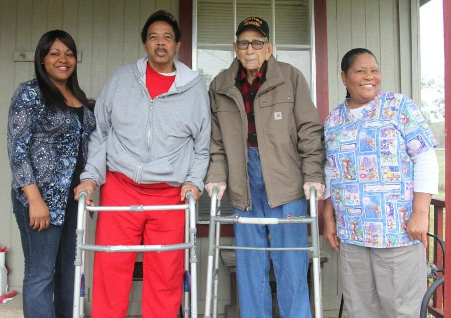 Celest Watson (left) owns Celestial Care and is assisted by aides such as Mary Johnson (right). They are hoping to have the inclines leading into the home altered to assist veteran residents Charles Fultom (second from left) and Edward S. Perez (second from right). Photo: Jacob McAdams
