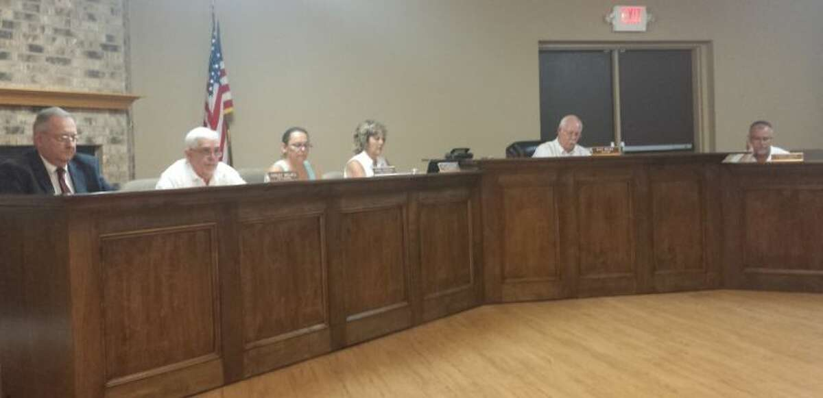 Roman Forest City Attorney Larry Foerster attended the June 10 city council meeting. Council members Conley Wallace, Aline Peeples, City Secretary Liz Mullane, Mayor Ray Ricks, and Councilman Chris Parr all sat behind the new court furniture during the meeting. Councilman Scott Baker (not pictured) was also in attendance.