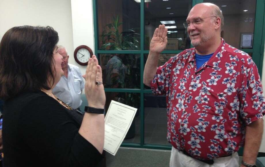 After defeating two opponents, reelected Councilmember Steve Rockey is sworn in by City Secretary Melinda Welsh.