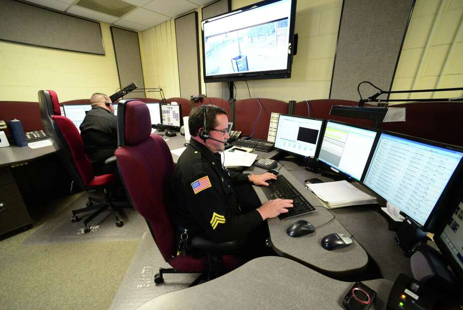Sgt. John Abbot, right, of the Saratoga County Sheriff's Office works 911 calls at Saratoga County's dispatch center Monday morning, March 31, 2014, in Ballston Spa, N.Y. (Will Waldron/Times Union archive) Photo: WW / 00026321A
