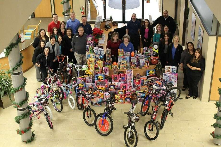 Credit union employees bought over 2300 worth of toys for the Pasadena Police Department to give to deserving children this Christmas.