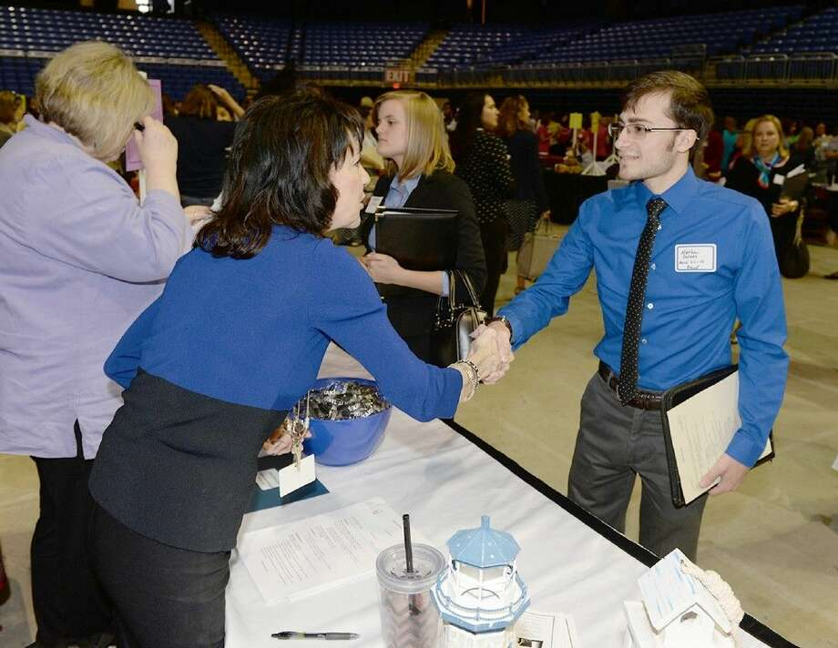 Windfern High School Principal Martha Strother greets Nathan Poteet at the CFISD Career Fair.