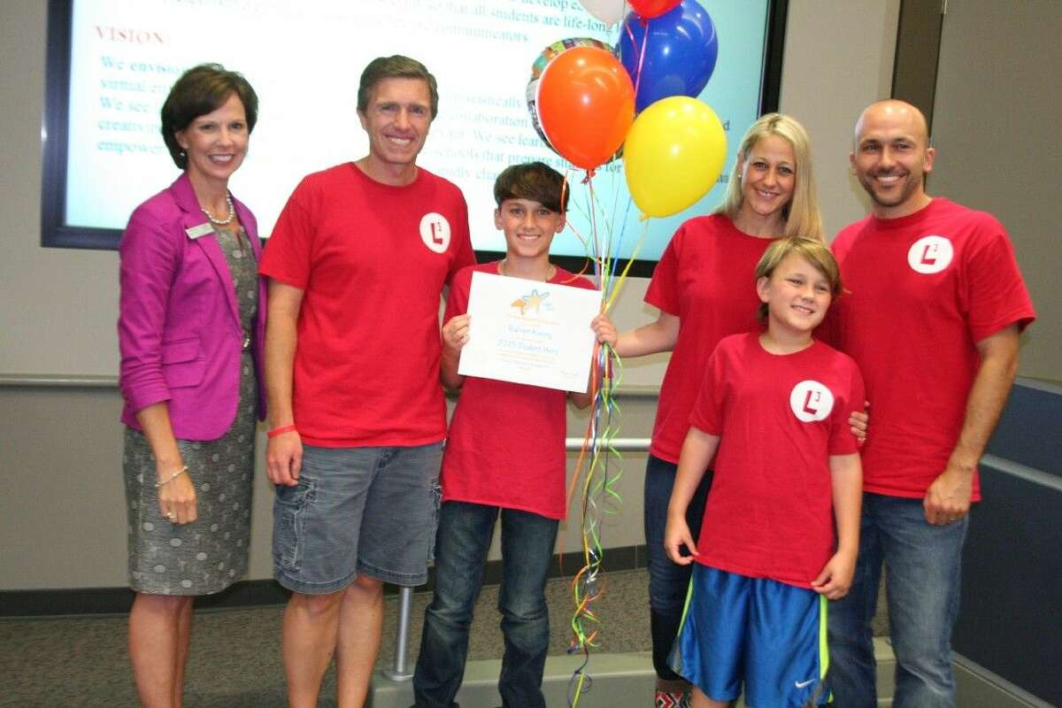 Barrett Kenny, center, with his family; Landon's dad, Scott Ahrendt; and State Board of Education Chair Barbara Cargill, was honored as the first 2015 Student Hero at the Humble ISD board meeting May 12, 2015.