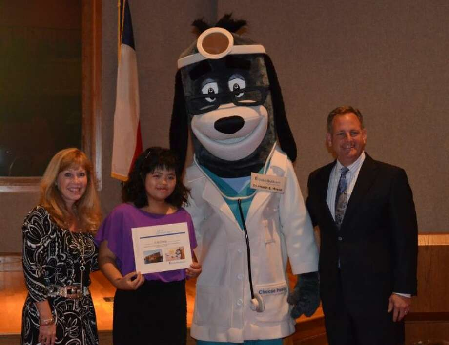 Left to right: Fort Bend ISD Deputy Superintendent Dr. Christie Whitbeck, Project SEARCH Intern Yi-No Cheng, UnitedHealthcare Mascot Dr. Health E. Hound and Don Langer, president of UnitedHealthcare Community Plan of Texas. Photo: Photo Courtesy UnitedHealthcare