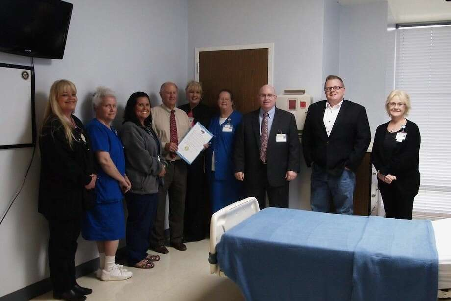 Liberty Mayor Carl Pickett presents the administrators and staff of the Liberty-Dayton Regional Medical Center with a proclamation recognizing the week of May 10-16 as National Hospital Week. From left are Rhonda Campbell, Joyce DeBarge, Amanda Thornton, Mayor Pickett, Cyndi Griffin, Judy Edmundson, CEO Jim Koulovatos, Board of Directors member Troy Beasley and Lisa Griffin. Photo: Casey Stinnett