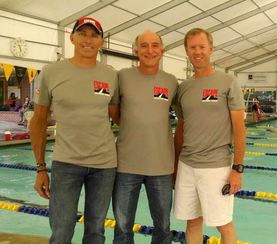 From left, friends and training partners Kent Morris, Michael Dwyer and Tim Vibrock completed the grueling Escape From Alcatraz Triathlon earlier this month in San Francisco. Dwyer had the fastest time in his age group, 65-69, finishing the event in just more than three hours.