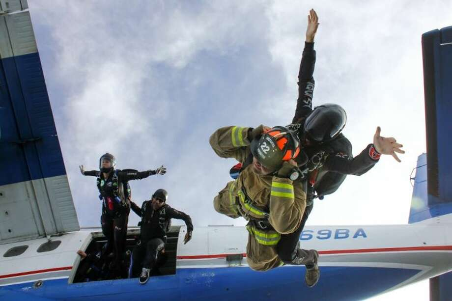 HFD firefighter Chris Lee jumps in full bunker gear during last year's Houston Firefighters Memorial Event at Skydive Spaceland.