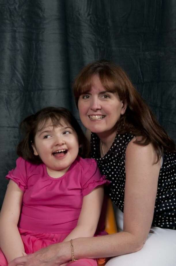 Kenna Seiler, chair of the Picture A Cure Gala, and her daughter Rachael, who suffers from Rett syndrome.