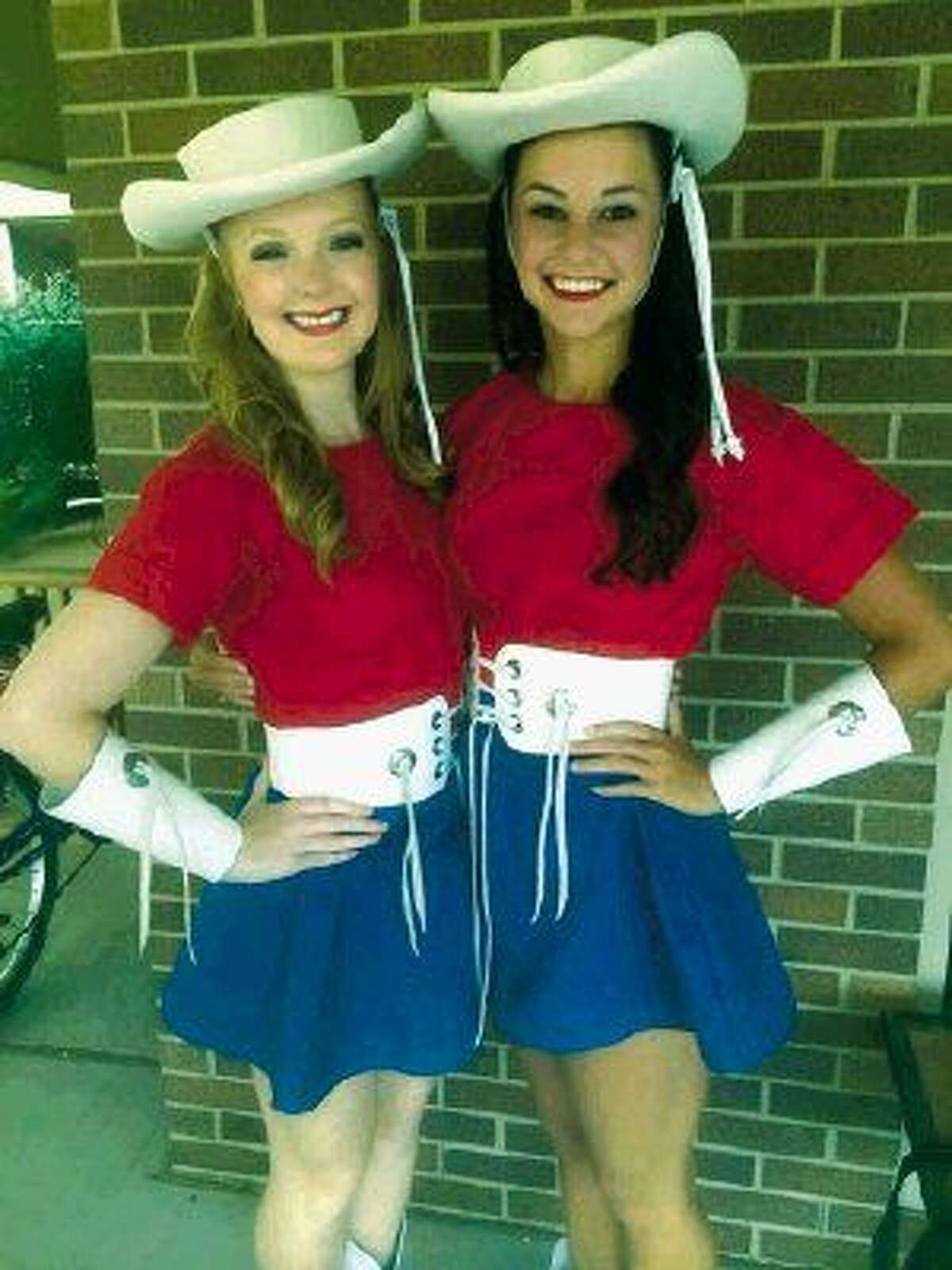 KHS graduate Shelby Westover and KPHS graduate Hannah Marucci pose together in their Kilgore Rangerette uniforms of red, white and blue.