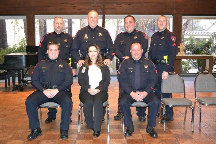 Constable Mark Herman recently announced promotions in his department. Pictured in the top row are Sgt. James Grohman, Constable Mark Herman, Corp. Ryan Belvin and Corp. Bryan Frazier. In the bottom row from left are Sgt. Aaron Strain, Clerk Supervisor Carla Morales, and Sgt. Jeff Lee. Photo: Submitted Photo