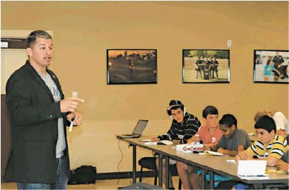 Undefeated mixed martial arts fighter and former WWE champ Daniel Puder recently spoke to La Porte area teens as part of an anti-bullying program.