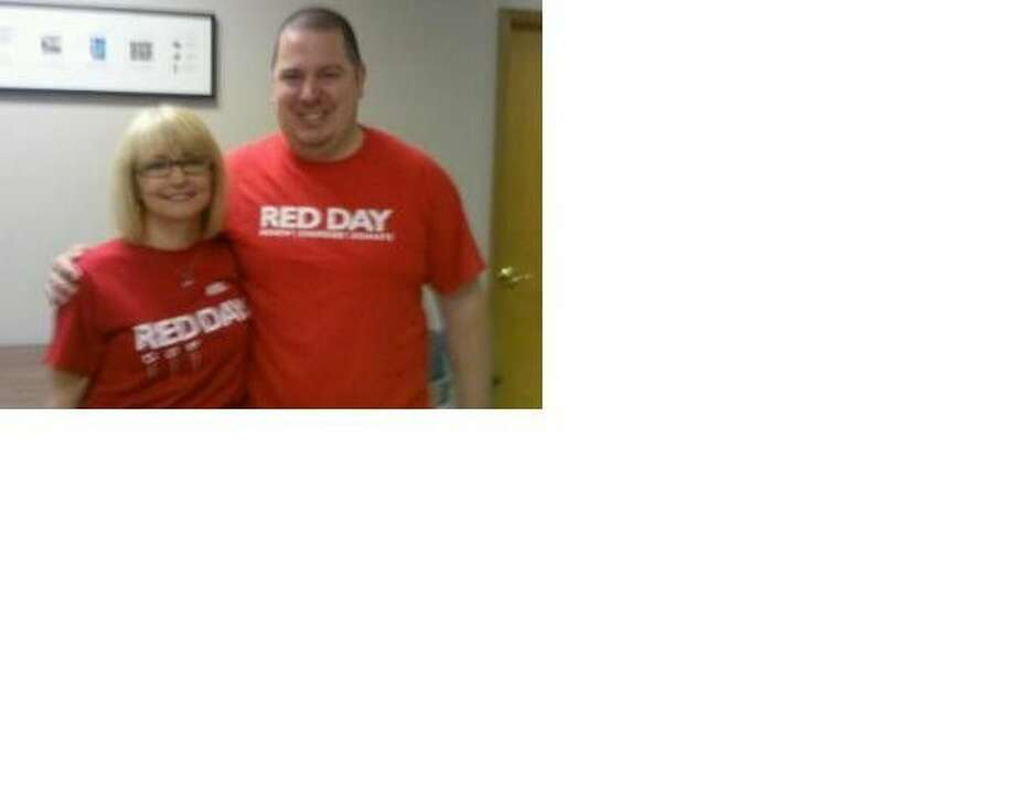 Tina Martin and Jeremy Williams represent Keller Williams while volunteering at the Humble Area Assistance Ministries for RED Day.