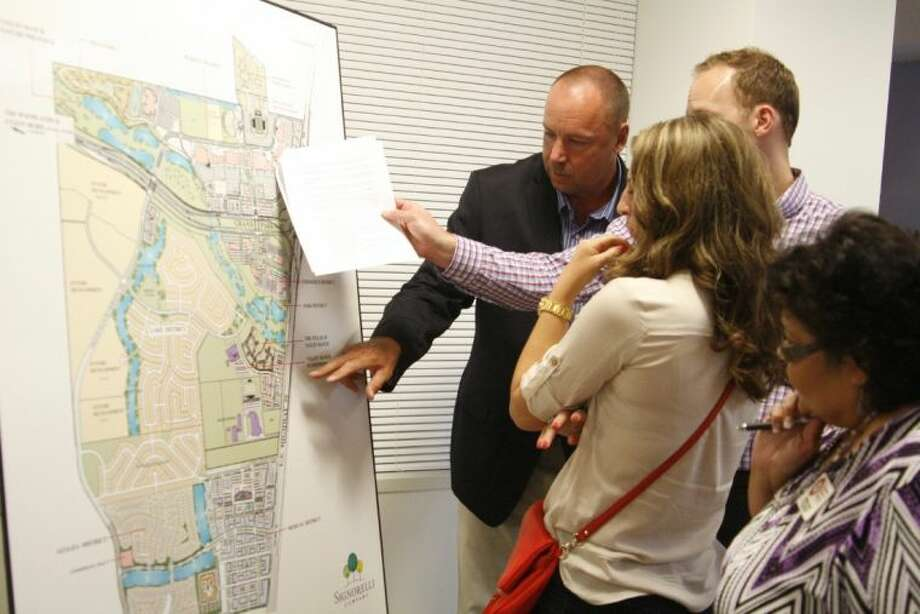 Guests check out the proposed plans of the Valley Ranch Town Center which includes commercial and residential property June 12, 2014.