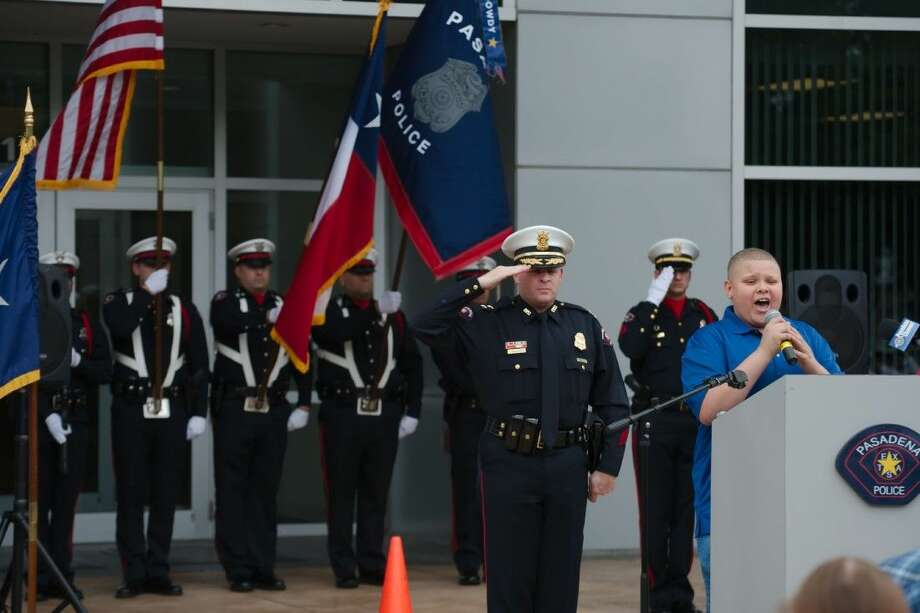 "Park View Intermediate School student Nicholas Connors, pictured here singing the National Anthem during the Annual Police Officer Memorial Service Thursday, will be performing the National Anthem at the opening ceremony of the Pasadena Strawberry Festival Friday at 5 p.m. He will also sing ""God Bless America"" during a special tribute to veterans later that evening."