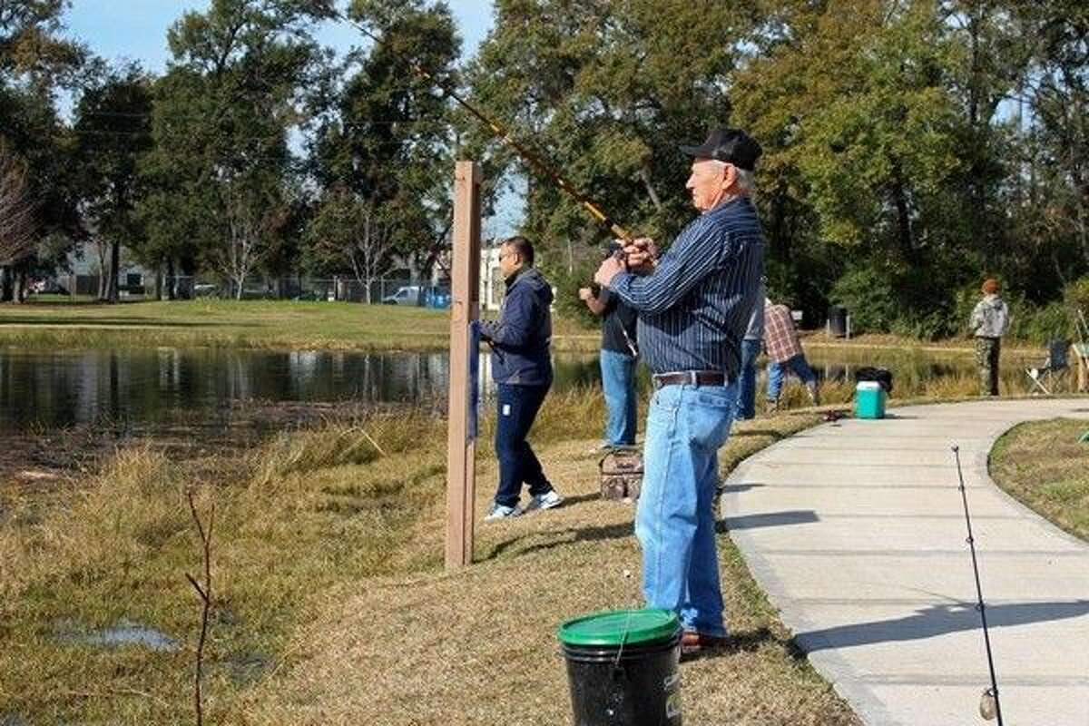 Milton Kabena fishes for rainbow trout at the newly restocked lake at Bane Park.
