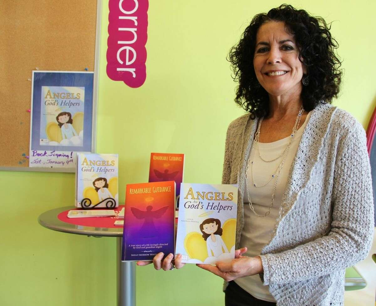 Shelly Morrow Whitenurg shows her two books at her book signing on Saturday, Jan. 9, at Menchie's in Cypress.