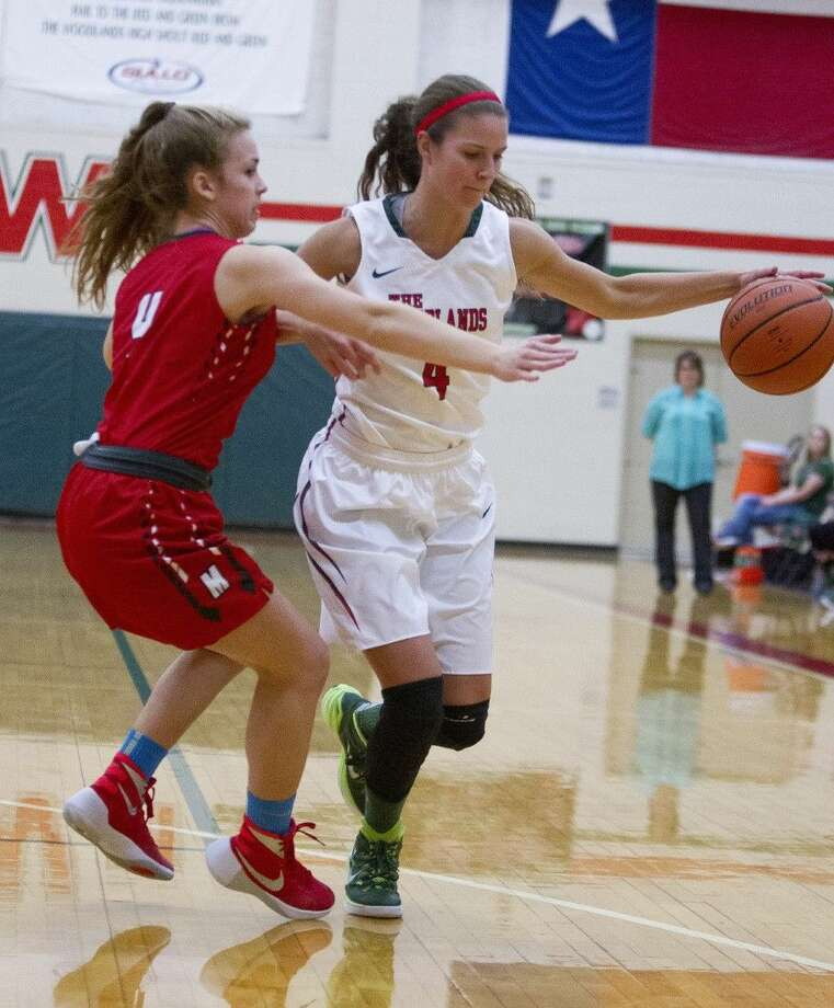 The Woodlands senior Payton Walker dribbles the ball against Tomball Memorial back in November. Walker is one of 16 Houston area girls basketball players to earn nomination for the McDonald's All-American game.