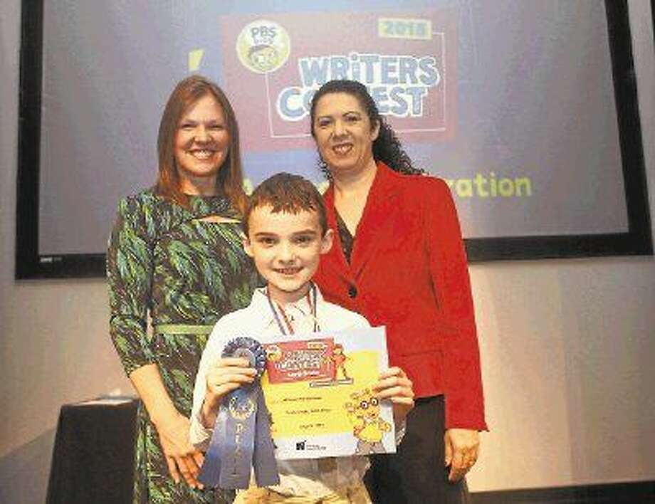 """William Charbonneau, a third grader at Mirus Academy in Katy, won first place in the 2015 Houston Public Media PBS Writers Contest for his story """"The Lonely Monster."""" William posed with children's author Chris Candor and Capella Tucker, content director of Houston Public Media, at an awards ceremony."""