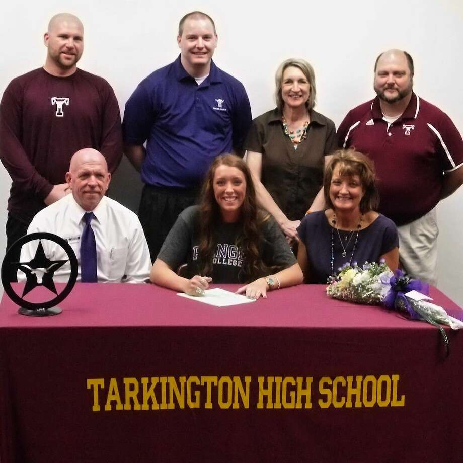 The LadyHorns' Anna Anderson will head to Ranger College for their next volleyball season. Anderson officially signed with Ranger at Tarkington High School Thursday afternoon, May 14, 2015. Seated with her are her parents, Buck and Avah Anderson. Standing, from left, are Tarkington ISD Athletic Director Brandon Carpenter, Ranger Head Volleyball Coach Brent Lewis, Tarkington Head Volleyball Coach Denise Johnson, and Asst. Coach Tom Bruce. Photo: Casey Stinnett