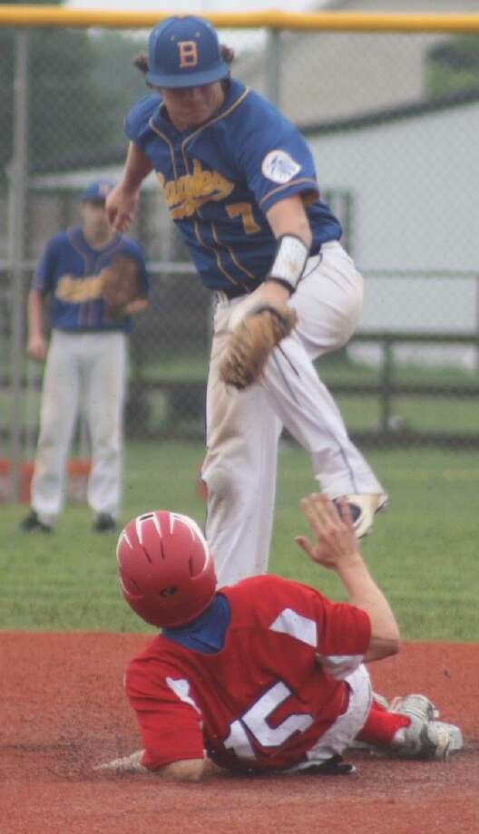 FBCA's Sterling McIntosh slides safely into second base as Brazosport Christian's Tyler Bergen leaps up to retrieve the late throw during sixth inning action Thursday. The Warriors were 6-of-6 in the stolen base department. Photo: Robert Avery