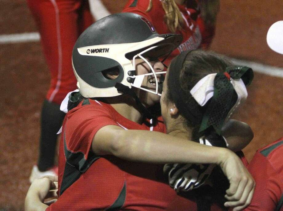 The Woodlands' Kerry Martinez celebrates after coming into score in the fifth inning against Kingwood. The Woodlands defeated Kingwood 7-2.