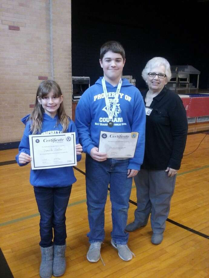 Pictured (l to r) are Danielle Sellier, Logan Sundberg, and Geography Bee Moderator Ona Thacker.
