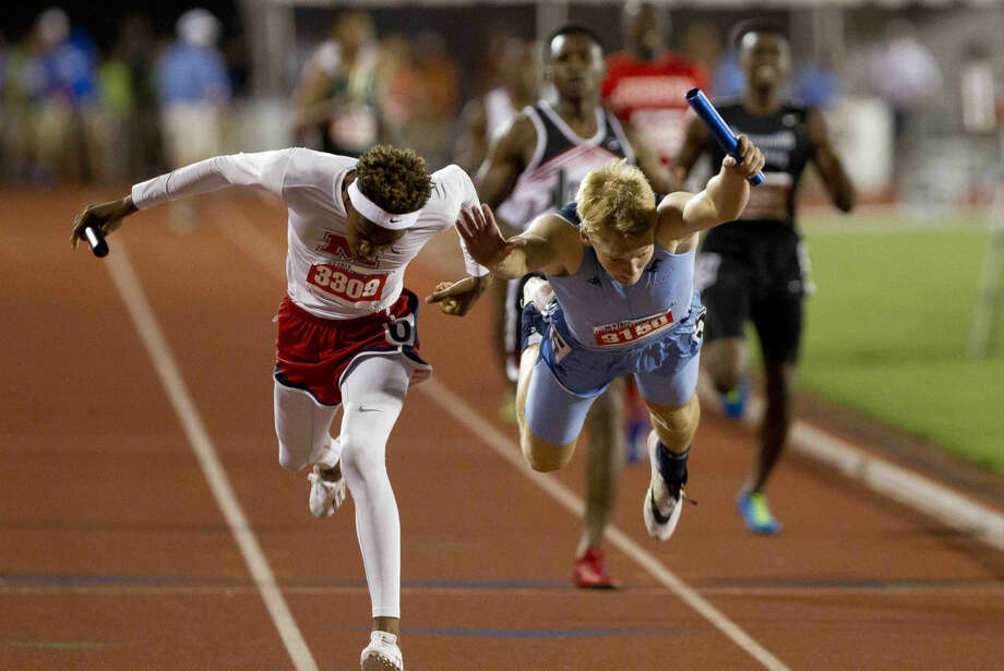 Kingwood's DeWitt Thomas dives toward the finish line edging out Manvel's Howard Fields to win the Class 6A competes 4x400 meter relay by .03 seconds during the UIL State Track & Field Championships in Austin Saturday. Go to HCNpics.com to view more photos from the state meet. Photo: Jason Fochtman