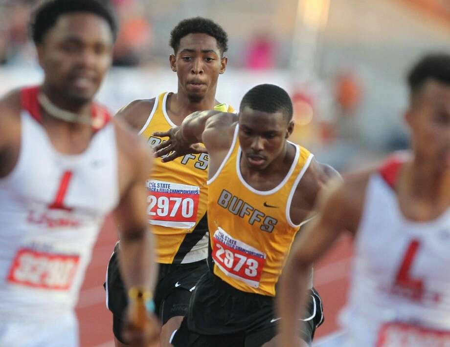 The Marshall 800-meter relay team of Cederian Lynch, Amere Lattin, Kendall Sheffield and Shamon Ehiemua set a state record with a 1:24.01, May 15 at the UIL State Track & Field Championships in Austin. The Buffalos won the Class 5A team championship with 90 points. Photo: Jason Fochtman