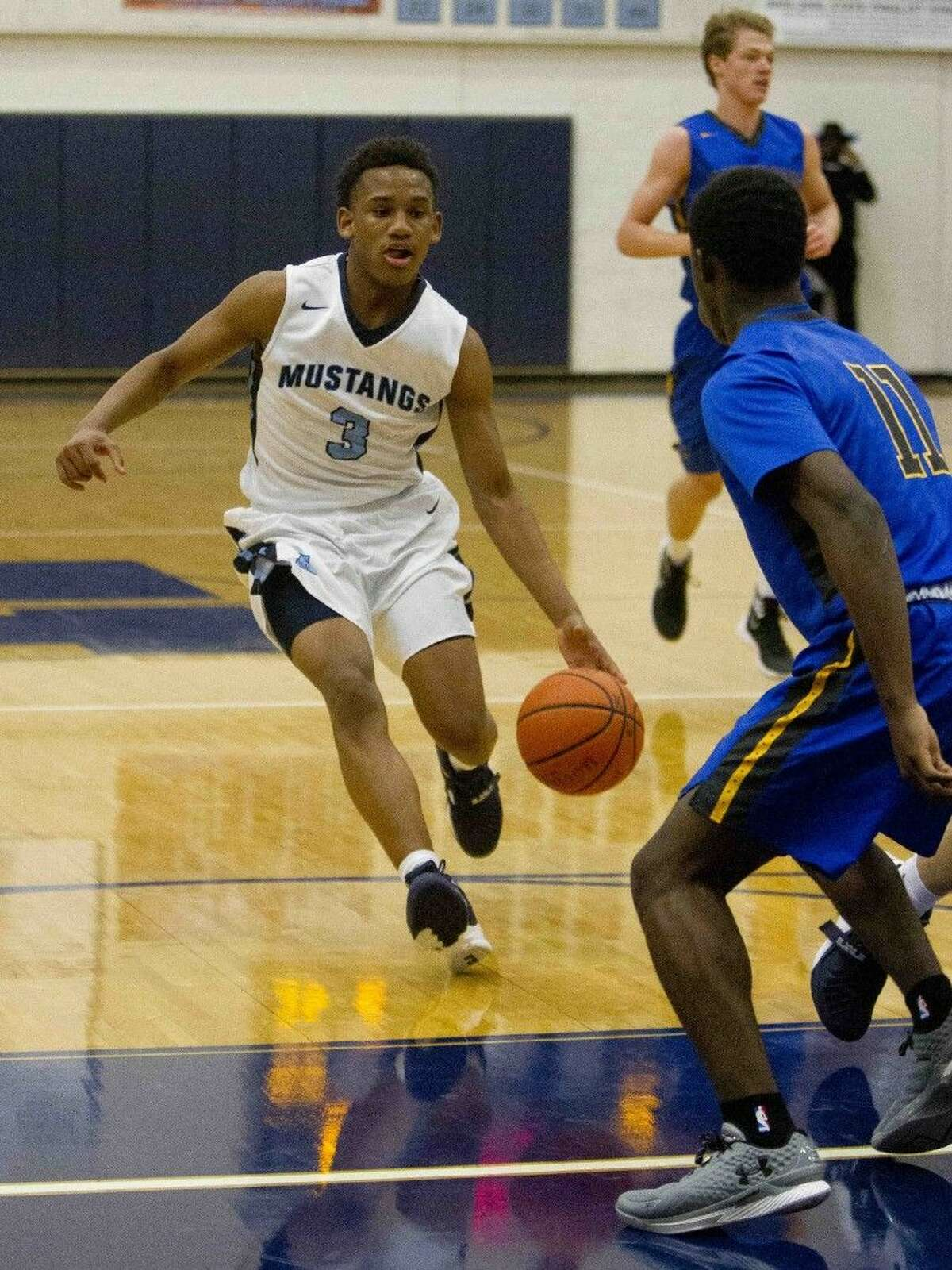 Kingwood guard Brandon Burrell dribbles toward the paint during a basketball game at the Insperity Holiday Classic at Kingwood High School Monday, Dec. 28, 2015. Go to HCNpics.com to purchase this image and view more photos from the tournament.