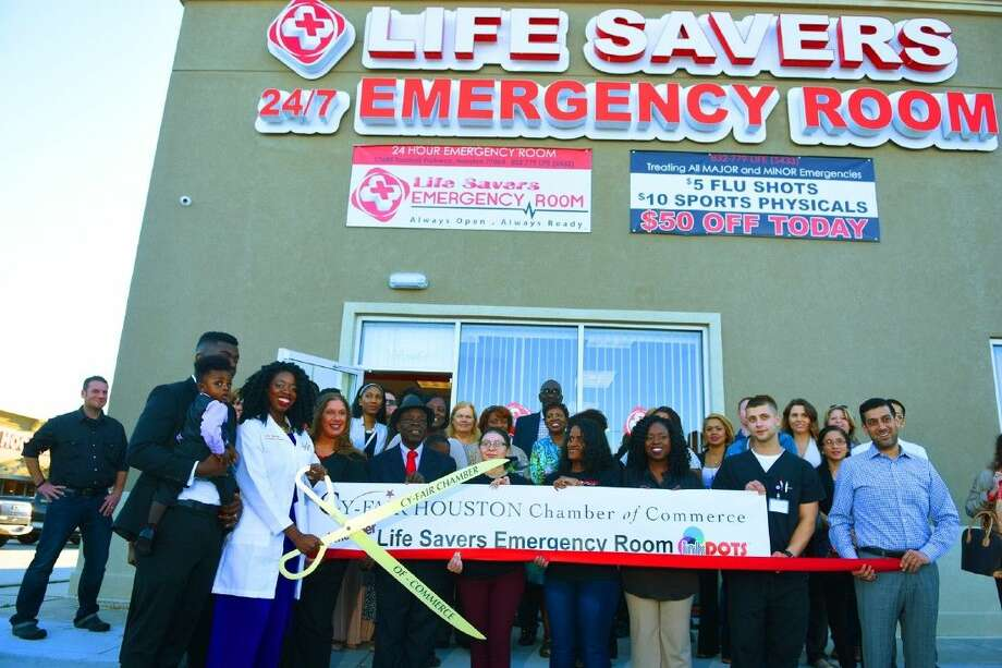 Dr. Foyekemi Ikyaator cuts the ribbon at the Cy-Fair Chamber of Commerce cereomony celebrating the opening her stand-alone emergency room on Friday, Jan. 15, at the Life Savers Emergency room located at 17685 Tomball Parkway. Photo: Tony Gaines