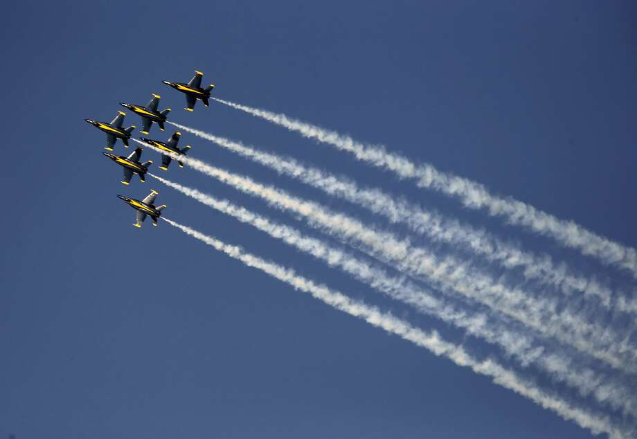 The Navy Blue Angels take to the skies over San Francisco Bay during Fleet Week in San Francisco , Calif., on Sat. October 10, 2015. Temperatures in San Francisco are forecast to gradually warm up through the remainder of the week, hitting 80 degrees by Saturday. Photo: Michael Macor, The Chronicle