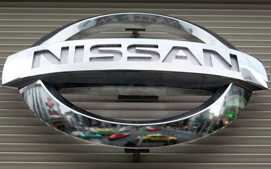 The U.S. government is investigating complaints that side air bags on some Nissan Versa small cars can inflate if the driver or passenger doors are slammed too hard. Photo: Associated Press /File Photo / AP2012