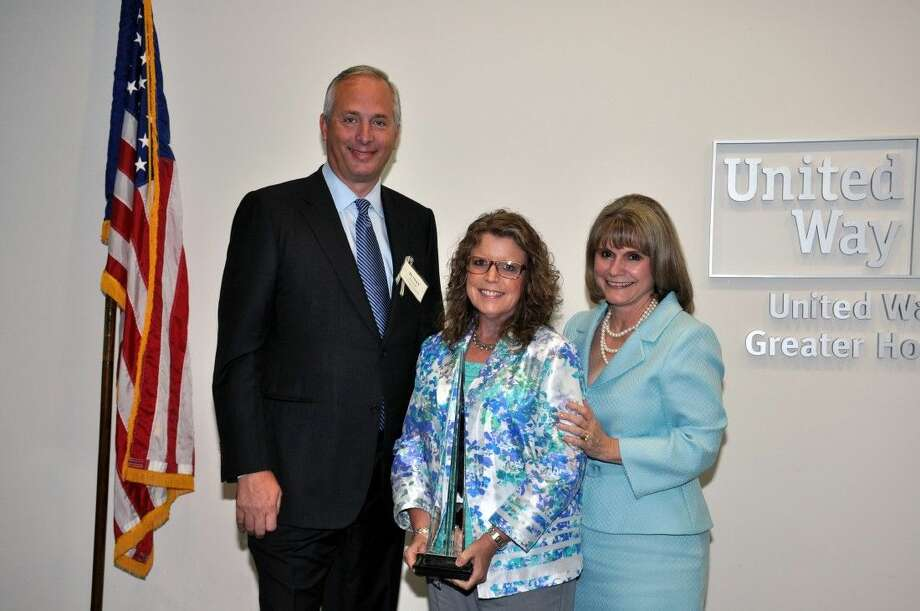 United Way of Greater Houston named Sandy Johnson, President and CEO Barrios Technology, as this year's recipient of the distinguished Robert W. Kneebone Volunteer of the Year Award. Pictured from left are Bobby Tudor, 2014 Robert W. Kneebone recipient, Johnson, and Anna M. Babin, President and CEO of United Way of Greater Houston.